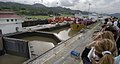 US Navy 070828-N-1810F-082 Visitors at the Pacific Ocean entrance of the Panama Canal observe a tanker in the Miraflores Locks, one of 3 locks used to raise and lower ships as they transit the canal.jpg