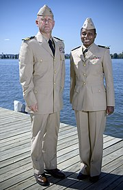 US Navy 070919-N-5319A-008 Two Sailors shows off the prototype uniform for service dress khaki, a throwback to the traditional WWII style uniform