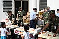 """US Navy 071211-N-3003C-156 Sailors from Forward Operating Location (FOL) Comalapa serve pizza to kids during a community relation project at the """"Hogar Del Nino"""".jpg"""