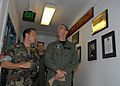 US Navy 080620-N-9860Y-005 Cmdr. Joe DiGuardo, commanding officer of Explosive Ordnance Mobile Unit (EODMU) 11, shows Adm. Jonathan Greenert, commander, U.S. Fleet Forces, the Wall of Remembrance.jpg
