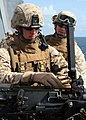 US Navy 081004-N-6764G-150 Lance Cpl. Kyle Vantine loads a .50 caliber machine gun.jpg