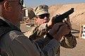 US Navy 081205-N-8730P-003 enior Chief Explosive Ordnance Technician Michael Manning instructs David Lopshire on the handling of a 9mm, 92F Beretta service pistol.jpg