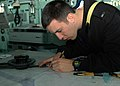 US Navy 090117-N-9134V-026 Lt. j.g. John Horwath, from Berwyn, Ill., plots a course on a navigation chart aboard the amphibious dock landing ship USS Carter Hall (LSD 50).jpg