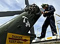 US Navy 090424-N-7280V-259 Aviation Machinist's Mate Airman Christopher Cockroft installs a tail gear box cover on an SH-60F Sea Hawk.jpg