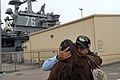 US Navy 090528-N-2344B-034 Personnel Specialist 1st Class Ricardo Rivera gives a goodbye hug to his wife before boarding the aircraft carrier USS Ronald Reagan (CVN 76).jpg