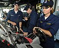 US Navy 090603-N-1831S-005 Midshipmen 2nd Class Sarah Van Cott, from the University of Michigan, and Ryan Frebowitz, from The Citadel, both enrolled in their school ROTC program, learn about shipboard navigation.jpg