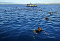 US Navy 090606-N-5345W-112 ailors from the amphibious dock landing ship USS Fort McHenry (LSD 43) and Marines from the 22nd Marine Expeditionary Unit (22 MEU) enjoy a swim call off the eastern coast of Greece.jpg