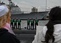 US Navy 091125-N-7179M-046 Family members wait to greet their Sailors as the Los Angeles-class attack submarine USS Montpelier (SSN 765) returns to homeport at Naval Station Norfolk after a six-month deployment.jpg