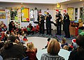 US Navy 091217-N-3731H-065 The Navy Band Mid-South Saxaphone Quartet perform Christmas carols for the children at Lakeland Funtime Learning Center.jpg