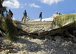 US Navy 100122-N-5244H-150 Residents of Leogane, Haiti, begin to clear the rubble left after an earthquake damaged their community.jpg