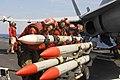 US Navy 100128-N-3327M-246 Sailors load ordnance onto an aircraft aboard USS Nimitz.jpg