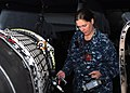 US Navy 110401-N-GL340-041 Machinist's Mate 1st Class Margaret Huff checks a jet engine for radiation.jpg