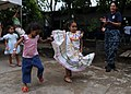 US Navy 110718-N-QD416-407 Hospital Corpsman 2nd Class Paola Foxhoven, from Guayaquil, Ecuador, watches children dance.jpg