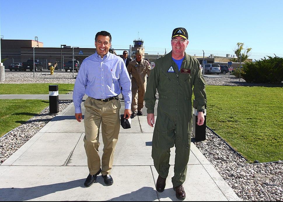 US Navy 110922-N-BF964-002 Rear Adm. John W. Miller, right, commander of the Naval Strike and Air Warfare Center, escorts Nevada Gov. Brian Sandova