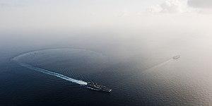 US Navy 120119-N-OY799-284 The Nimitz-class aircraft carrier USS John C. Stennis (CVN 74) breaks away from USS Abraham Lincoln (CVN 72) after a tur.jpg