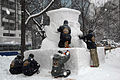 US Navy 120203-N-ZI955-021 The Navy Misawa snow sculpture team sculpts a snow bust of.jpg