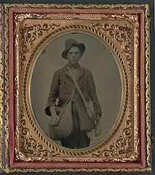 Unidentified soldier in Confederate uniform with Gardner patent canteen and haversack LCCN2011647966.jpg