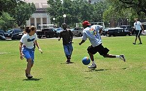 Kickball - Adults playing kickball.