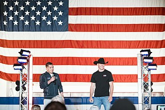 Donald Cerrone - Cerrone (right) on stage with Anthony Pettis for a USO tour