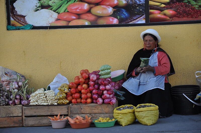 English: Street vendor selling vegetables in San Antonio, Ecuador.