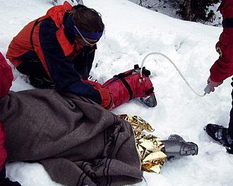 Vacuum splint - Vacuum splint being applied to the leg of an injured skier