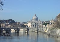 St. Peter's Basilica, believed to be the burial site of St. Peter, seen from the River Tiber. The iconic dome dominates the skyline of Rome.