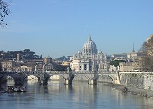 Religion in Italy - St. Peter's Basilica, viewed from the Tiber, the Vatican Hill in the back and Castel Sant'Angelo to the right, Rome (both the basilica and the hill are part of the sovereign state of Vatican City, the Holy See of the Catholic Church).