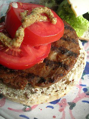 English: Veggie burger (vegan). With mustard, ...