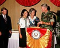 Vice President Dan Quayle looks as his wife, Marilyn Quayle accepts a gift from Lieutenant General Norman H. Smith.jpg