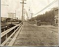 View southeast on Alki Avenue, with railroad tracks and flour mill, West Seattle, February 19, 1913 (MOHAI 8715).jpg