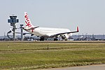 Virgin Australia (VH-ZPT) Embraer ERJ190-100 IGW taking off on runway 25 at Sydney Airport.jpg
