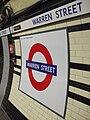Warren street stn Northern roundel.JPG
