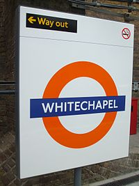 Whitechapel station East London roundel.jpg