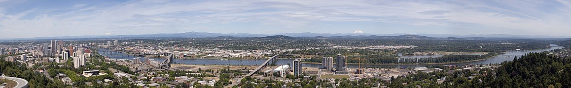 The bridges, from right to left, are the Sellwood, Ross Island, Marquam, Hawthorne, Morrision, Burnside, Steel (the black bridge that is partially obscured), Fremont (the arch bridge at far left). The mountains, from right to left, are Mount Hood, Mount Adams (only the tip is visible) and Mount Saint Helens.