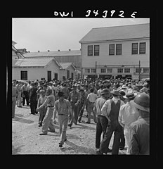 Workers leaving the Higgins shipyards at four pm 8d31653v.jpg