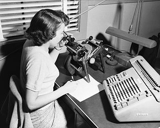 Computer - A female computer, with microscope and calculator, 1952