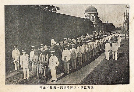 Japanese colonial soldiers march Taiwanese captured after the Tapani Incident from the Tainan jail to court, 1915. Xilaian Incident.jpg