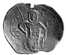 Photograph of an imperfectly-shaped medieval coin carrying the image of a man with a helmet, armour and spear