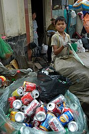 A young boy recycling garbage in Ho Chi Minh City, Vietnam in 2006