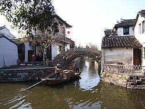 Zhouzhuang - Boat in Zhouzhuang passing through canals