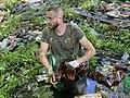 Артём Приходько расчищает реку Уды от пластика.jpg