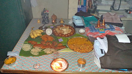 A homemade feast and clothes as gifts on Diwali night. - Diwali