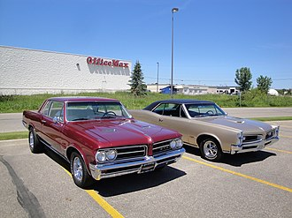 Pontiac GTO - A 1964 GTO (left) with a 1966 GTO (right) showing the difference in design