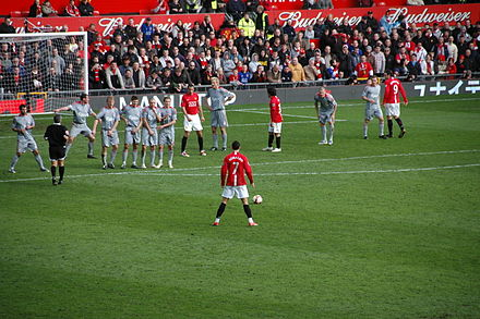 Cristiano Ronaldo preparing to take a free kick in a 2009 match between Manchester United and Liverpool 2009-3-14 ManUtd vs LFC Ronaldo Freekick Back.JPG