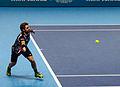 2014-11-12 2014 ATP World Tour Finals Stanislas Wawrinka reaching for forehand by Michael Frey.jpg