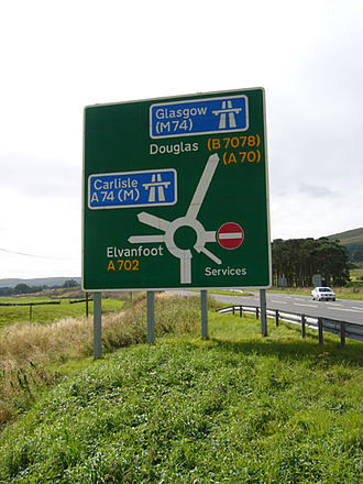 Roads in the United Kingdom - A typical roundabout sign on a primary road