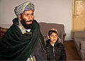 A 13-year-old Afghan boy stands with his father after returning home to Kandahar province, Afghanistan, Dec. 22, 2011 111222-A-NC985-037.jpg