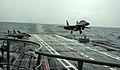 A MiG-29K performs a touch and go landing on INS Vikramaditya during Narendra Modi's visit.jpg