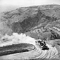 A Priest 105mm self-propelled gun negotiates a hairpin bend on a mountain road near Mondaino during the advance through the Gothic Line, Italy, 6 September 1944. NA18392.jpg