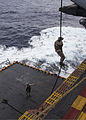 A U.S. Marine assigned to the 26th Marine Expeditionary Unit (MEU) maritime raid force participates in fast rope training from an MV-22B Osprey tiltrotor aircraft aboard the amphibious assault ship USS Kearsarge 130319-M-BS001-047.jpg